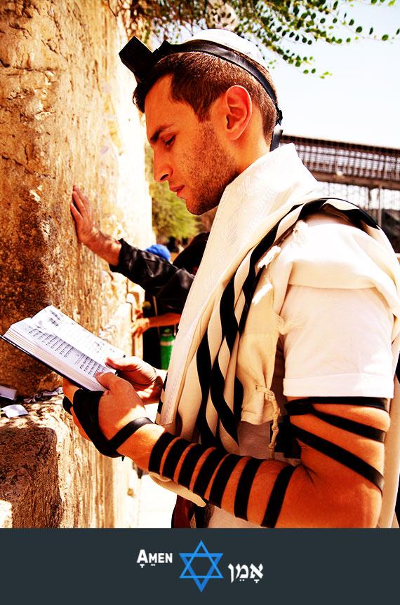 Young Man Praying Tefillin Kotel