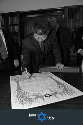Male Witness Signing The Ketubah